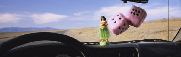 Hula girl fluffy dice car dashboard