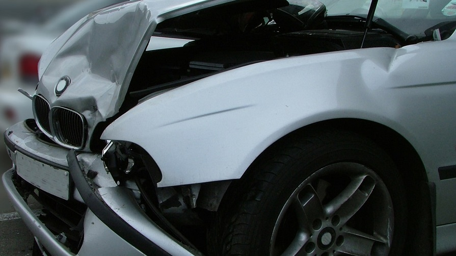 silver bmw involved in car accident