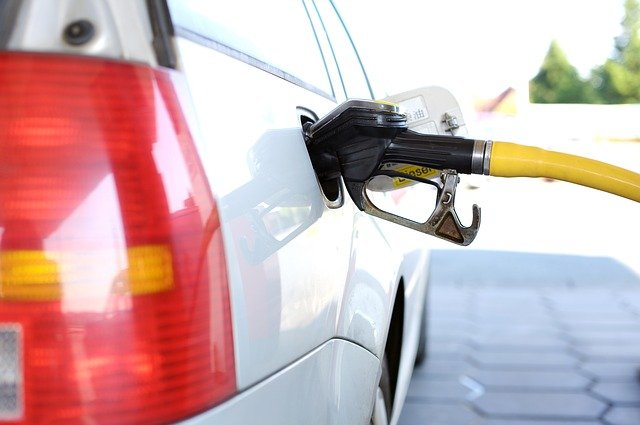 person fueling up at pump